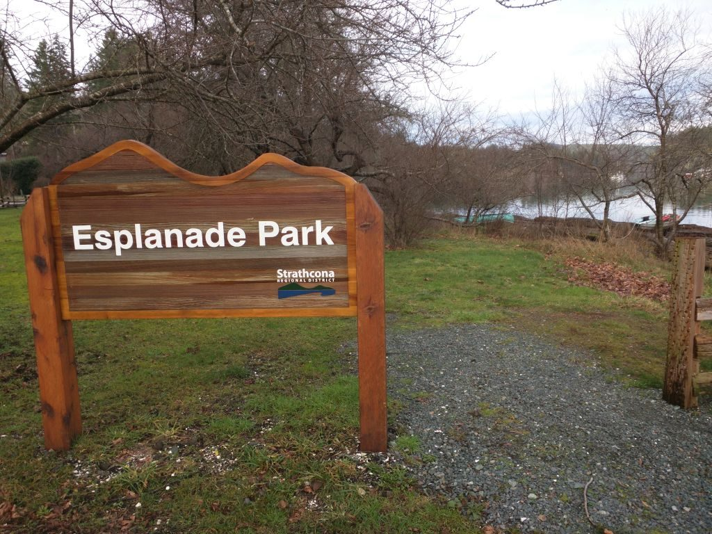 Esplanade Park sign at the start of the Wild Plum Tree Trail beside the Heriot Bay Government Dock parking lot at the foot of Alder  Road